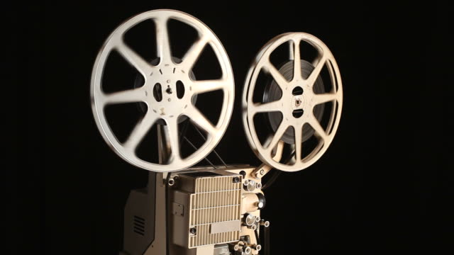 old fashioned film projection in dark - film feeder stock videos & royalty-free footage