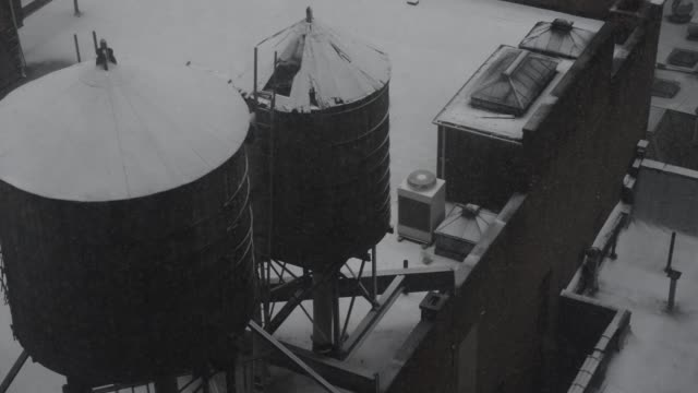old fashioned new york water towers during a snow. - equipment stock videos & royalty-free footage