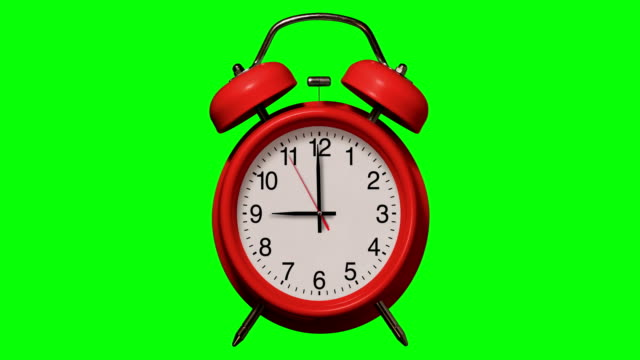 old fashioned red alarm clock rings at 9 o'clock on chroma key background - school bell stock videos & royalty-free footage