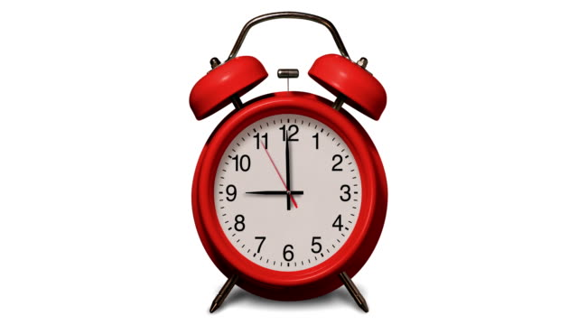 old fashioned red alarm clock rings at 9 o'clock on white background - second hand stock videos & royalty-free footage