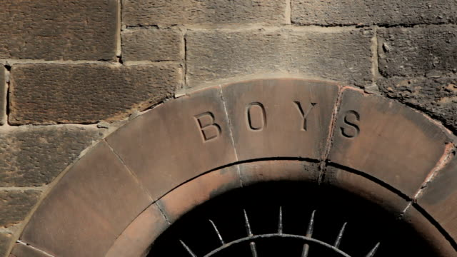 old fashioned school entrance for boys only - prison education stock videos & royalty-free footage