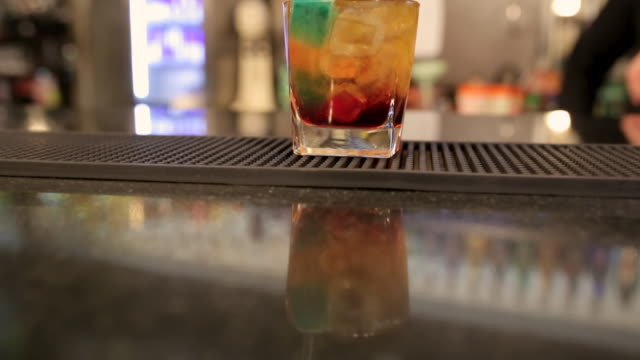 old fashioned summer whiskey cocktail on bar counter in night club ready to drink - jellybean stock videos & royalty-free footage
