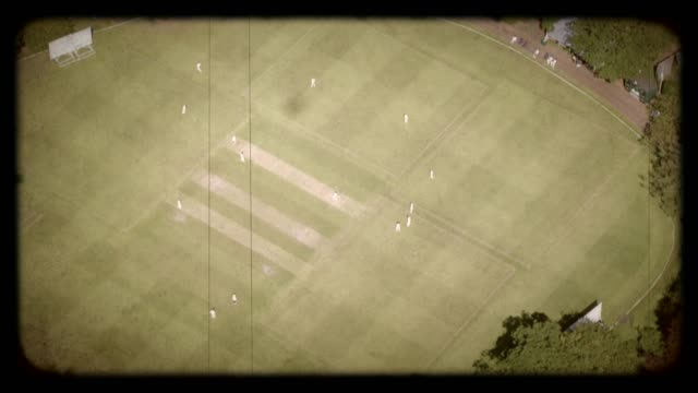 old film aerial view of a cricket match, londra, regno unito. 4k - cricket video stock e b–roll