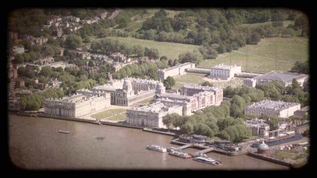 old film aerial view of greenwich park in london, uk. 4k - royalty stock videos & royalty-free footage