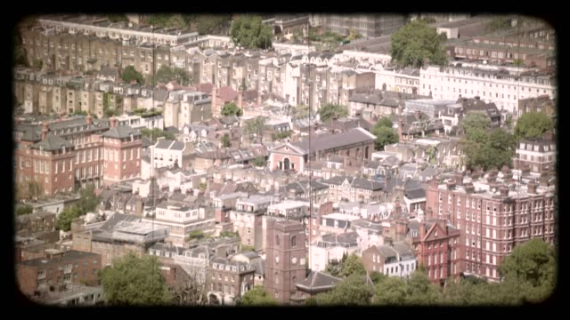 old film aerial view of housing developments in london, uk. 4k - residential district stock videos & royalty-free footage