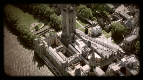 old film aerial view of the houses of parliament, london, uk. 4k - house of commons stock videos & royalty-free footage