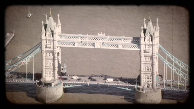 old film aerial view of tower bridge, london, uk. 4k - ship stock videos & royalty-free footage
