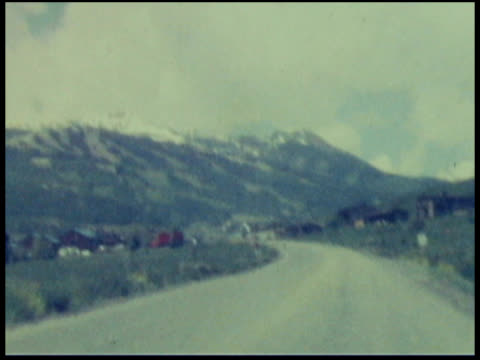 stockvideo's en b-roll-footage met old film of countryside and mountains: north america or europe - 1946