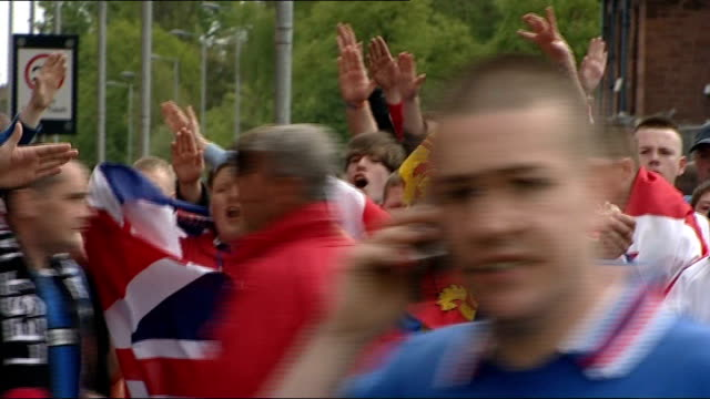 old firm clash passes peacefully after recent tensions scotland glasgow ibrox stadium ext crowds of glasgow rangers fans chanting songs and dancing... - neckwear stock videos and b-roll footage