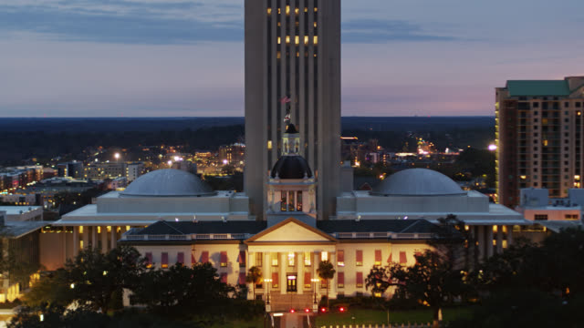 old florida state capitol lit up at twilight - drone shot - florida us state stock videos & royalty-free footage
