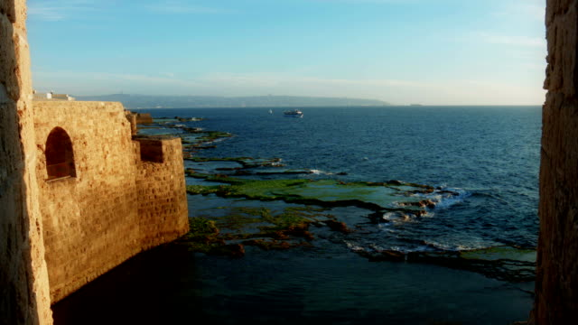 old fort at the seaside. sunset - akko stock videos and b-roll footage