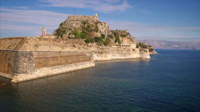 old fortress guards the entrance to harbor in corfu, greece - greece stock videos & royalty-free footage