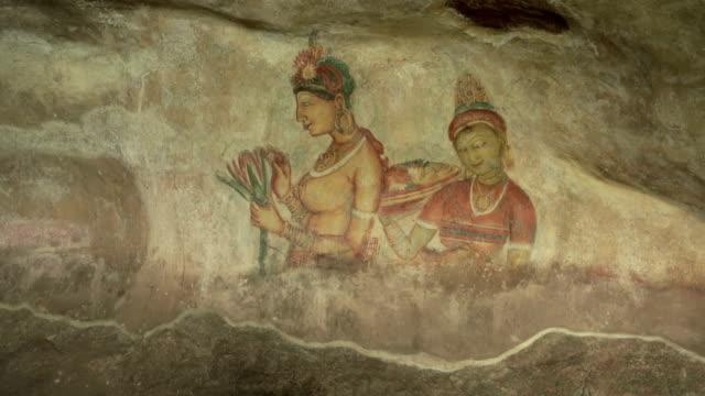 old fresco paintings in a cave in sigiriya, sri lanka - mural stock videos & royalty-free footage