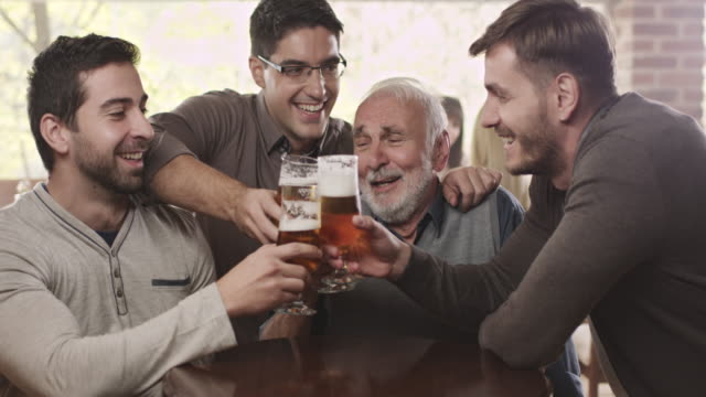 Old friends in bar drinking beer