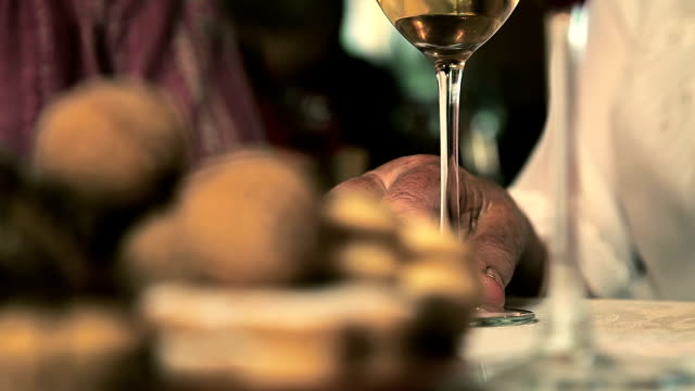 hd: old hands and glass of wine - wine glass stock videos and b-roll footage