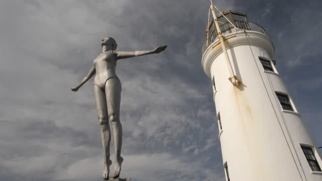 old harbour lighthouse and diving belle sculpture, scarborough, north yorkshire, yorkshire, england, united kingdom, europe - sculpture stock videos & royalty-free footage