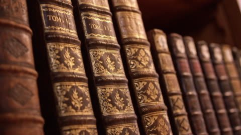 ds old hardcover books on the shelf - shelf stock videos & royalty-free footage