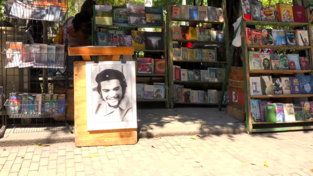 Old Havana, Cuba: Che Guevara photograph for sale along other old historic souvenirs.