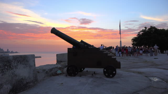 Old Havana Cuba: colonial cannon in the multi coloured sky of the dusk.