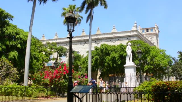 old havana cuba habana  plaza de armas with statues and tourists walking colorful cuba today - male likeness stock videos & royalty-free footage