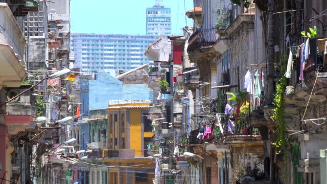 Old Havana Cuba: Line of clothes in balconies and worn out buildings in the historical neighborhood