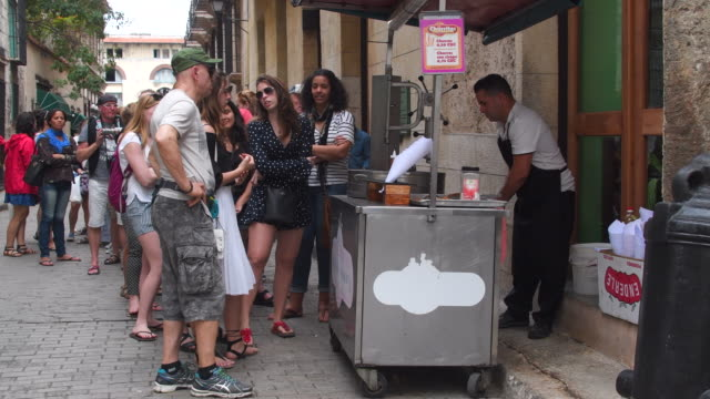old havana cuba: local people and tourists lining up in a 'churros' food cart - churro stock videos & royalty-free footage