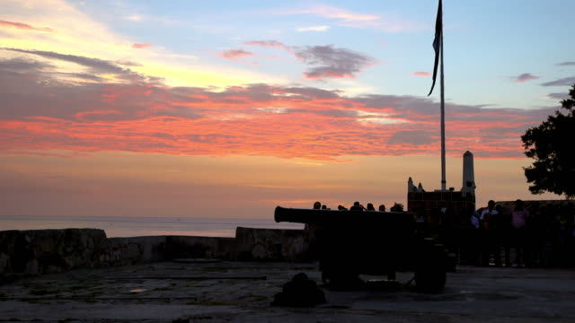 Old Havana, Cuba: The Cannon Shot ceremony at 9.00 pm (preliminary activities) . Tourists start gathering to presence the symbolic closing of the colonial city walls