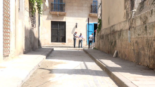 old havana, havana, cuba-july 1, 2014: establishing shot of enna street which is considered the narrowest and shortest street on the caribbean... - trivia stock videos & royalty-free footage