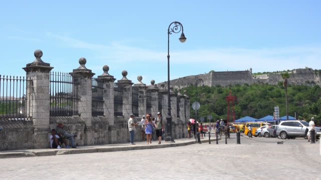 old havana, havana, cuba-july 1, 2014: the image shows tourists in the area. the street is made of colonial cobblestone and the fence of stones and... - metalwork stock videos & royalty-free footage