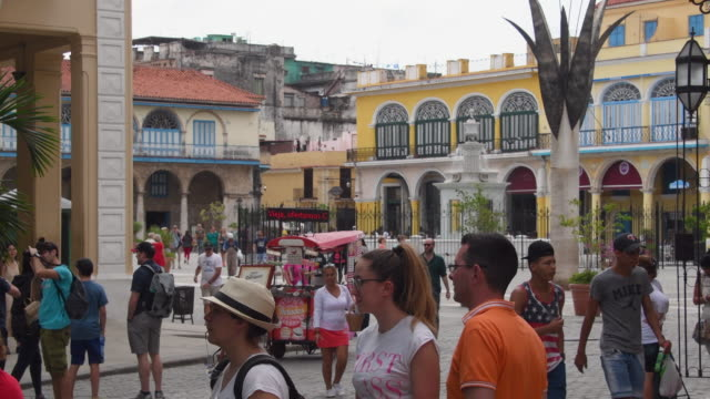 la habana vieja is the citycenter and one of the 15 municipalities forming havana / it has the second highest population density in the city and... - plaza vieja stock videos and b-roll footage