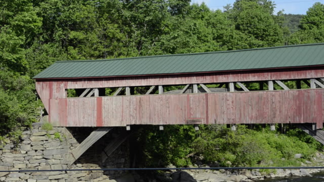 ms zo old historic red old covered bridge on river / taftsville, vermont, united states - vermont stock videos & royalty-free footage