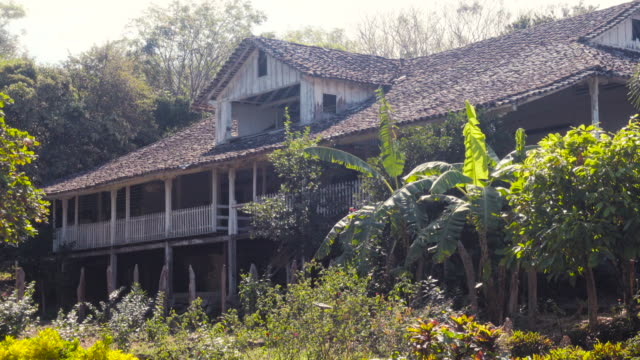 Old house made by wood in a tropical rural location. Magdalena finca farm and hostel in Ometepe, Nicaragua. Retreat - Brief