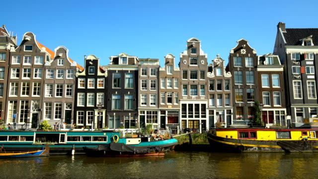 old houses in amsterdam with canal, time lapse - canal stock videos & royalty-free footage