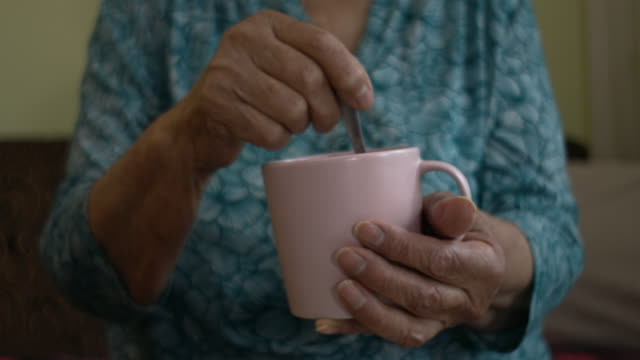 old human hands - mug stock videos & royalty-free footage