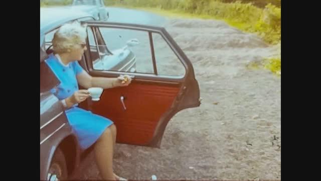 old lady drink tea in car, 4k digitized footage - headphones stock videos & royalty-free footage
