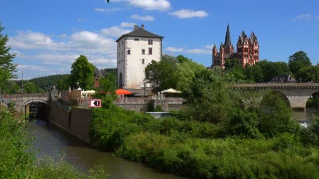 old lahn bridge and cathedral of limburg, limburg an der lahn, westerwald, hesse, germany, europe - circa 13th century stock videos & royalty-free footage