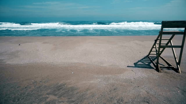 old lifeguard chair on the beach ( i̇stanbul / şile beach ) - lifeguard chair stock videos & royalty-free footage