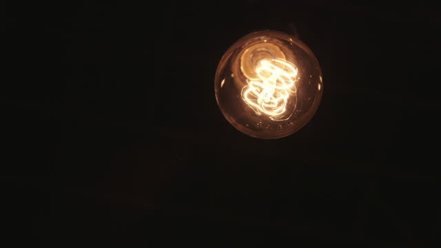 old light bulb moving above camera - energy efficient stock videos & royalty-free footage