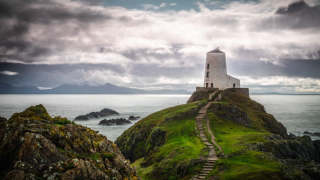 old lighthouse at llanddwyn island, anglesey, wales - snowdonia stock videos & royalty-free footage