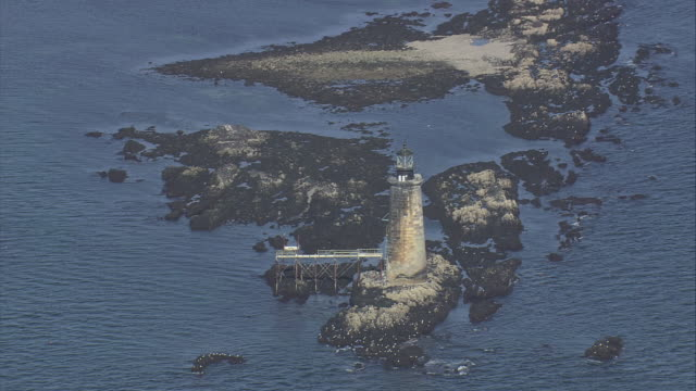 stockvideo's en b-roll-footage met aerial old lighthouse on off-shore island / calendar islands, maine, united states - passagiersboot