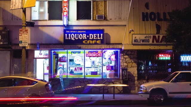 ws zi t/l old liquor store window at sunset / hollywood, california, usa.   - liquor store stock videos and b-roll footage