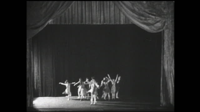 old man and girl in the audience watching dancers performing on stage; the two claps with the audience at the end of the performance - audience stock videos & royalty-free footage