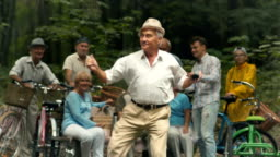 Old man dances in the park