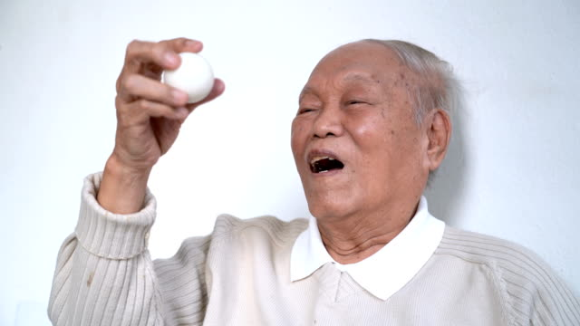 old man exercising his eyes by moving white ball in and out to improve eyesight - wrist stock videos & royalty-free footage