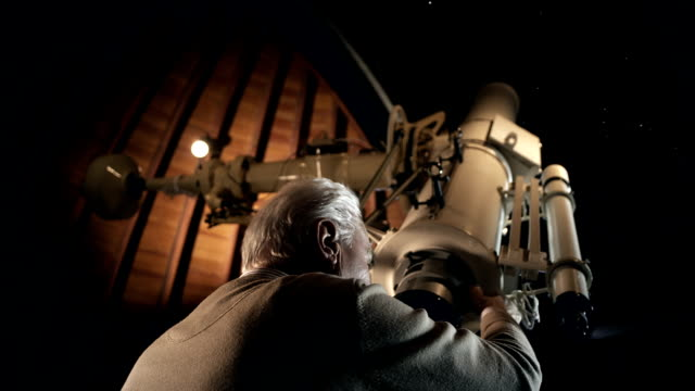 Old man in observatory