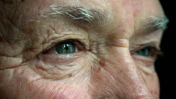 old man opens his eyes: closeup portrait