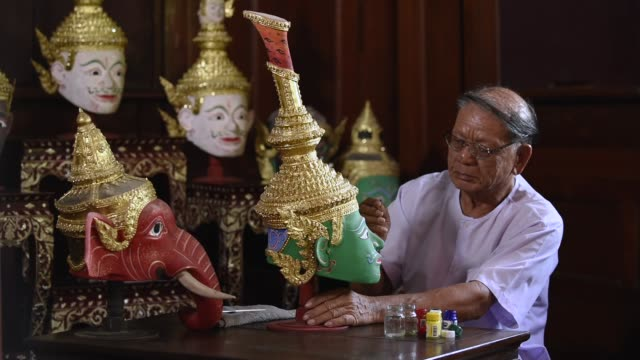 old man painting ramayana ramen mask. the india historical story welcome to thailand concept.culture of thailand - god stock videos & royalty-free footage