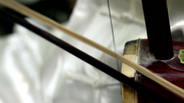 old man playing chinese traditional erhu in the park - violin stock videos & royalty-free footage