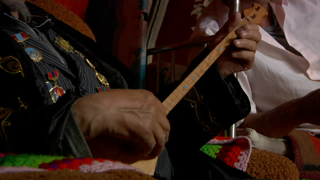 old man playing two stringed instrument called topshur - stringed instrument stock videos & royalty-free footage