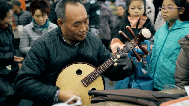old man plays traditional chinese musical instrument ruan - cultures stock videos & royalty-free footage
